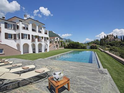 Photo for Villa Storica with stunning lake view surrounded by 10 acres of olive trees