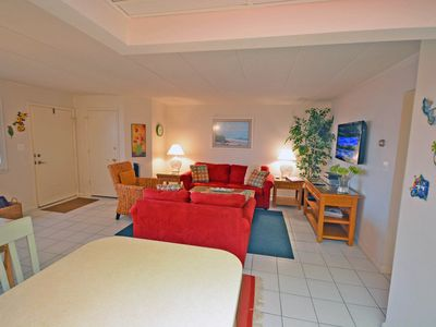 Spacious, colorful 2 bedroom condo with free WiFi just a short stroll to the beach among the excitement of downtown only a few streets from the boardwalk!