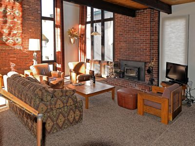 Photo for 3 min walk to ski-in/out point! 2 Story, 3BR w/fireplace on slopes! Low rates!