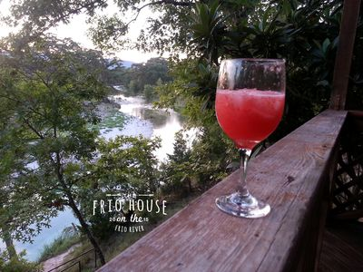 Sit on the deck with a view nearly half a mile up the Frio River.