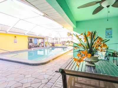 Photo for Amazing GULF ACCESS  2-bedroom w/ Heated pool and Boat Slip! Rent a boat…. Fish from OUR dock or go Deep Sea Fishing W/ 1 OF OUR CAPTAINS! Relax by our heated pool!! Enjoy… YOU are on vacation!