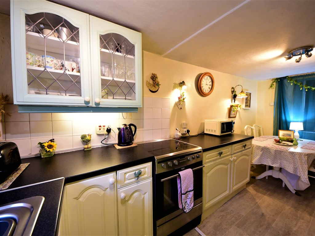 Smithy cottage kitchen area - Property Image 4 The Old Smithy Cottage With Private Hot Tub Near Seaside Morfa Nefyn