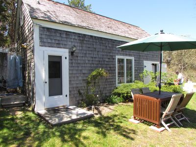 Photo for Cozy, book lined cottage for a quiet get away within walking distance of the bay