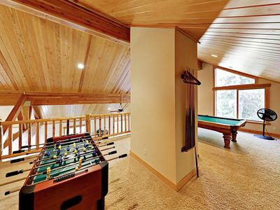 Loft  - A loft area provides additional living space and includes foosball and a pool table.