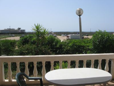 Photo for Beachfront apartment with balcony / garden.