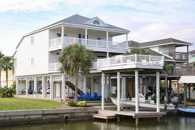 Exterior - This 2-story raised home boasts prime indoor/outdoor entertaining with 3 decks and a private boat dock.