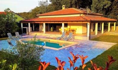 Photo for New, modern holiday home ***** in a quiet location with pool, near the sea, carport