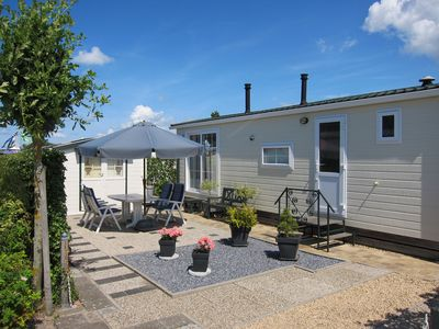 Photo for Family friendly chalet Emma on the 5 * family park Julianahoeve, on the beach