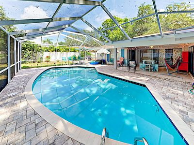 Photo for Spacious Coastal-Chic Retreat: Screened Pool, Yard & Grill - Near Beach!