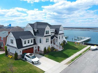 Photo for Bay Front Mansion w/ Panoramic Sunset Views, Game Room, Open Kitchen & Dock!