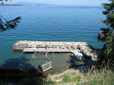 The view of our private dock and beach on Flathead Lake from the Log Cabin deck