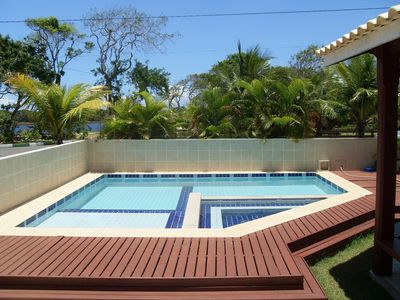 Photo for Great beach house in cond closed, 100% air-conditioned, with pool and jacuzzi