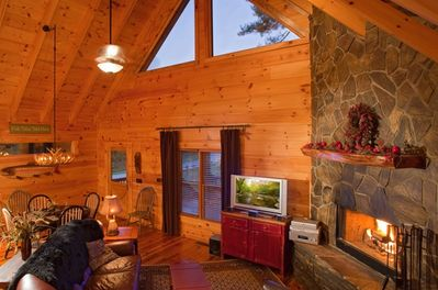 Luxurious Living with Leather Furnishings and a Stunning Wood Burning Fireplace