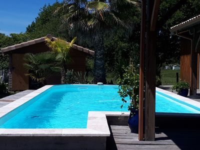 Photo for Wooden house with swimming pool for 8 people in the heart of Arcachon Bay