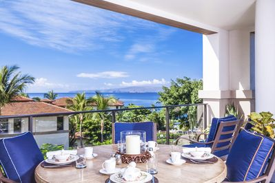 A Large 6 Person Table with Panoramic Ocean Views.