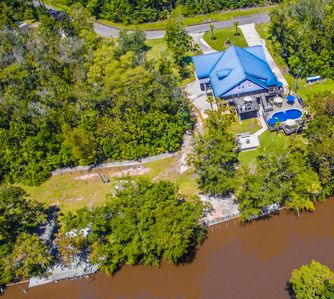 Drone View of River, Back of house, fire pit and Swimming pool (ck out video)