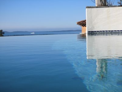 Photo for VILLA CLIMATISEE SWIMMING POOL OVERLOOKING SEA ON THE ISLAND OF PORQUEROLLE AND LAKE
