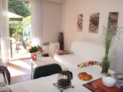 Photo for Charming studio, close to everything with parking and private pool in residence.