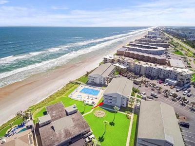 Photo for STUNNING newly renovated (2018) ground floor condo, direct OCEAN & POOL front!!!