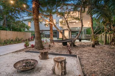 the lovely outdoor area with fire pit and hammock