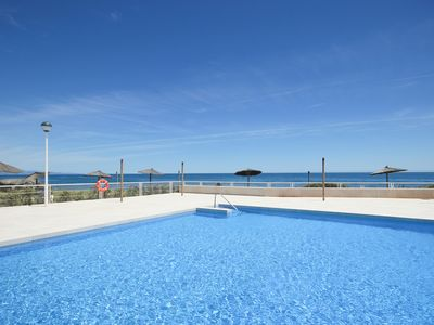 Photo for Stunning beachfront 2 bedroom apartment in Casares del Mar