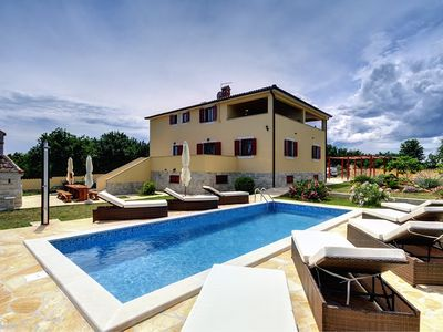 Photo for Detached villa with private pool, 4 bedrooms, 5 bathrooms, air conditioning, WiFi, sauna, whirlpool, fitness, deck chairs and great barbecue area