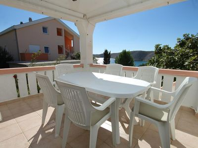 Photo for Three bedroom apartment with terrace and sea view Vlašići, Pag (A-4319-c)