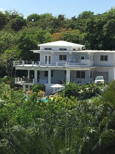Photo for Lush hilltop retreat overlooking the Caribbean