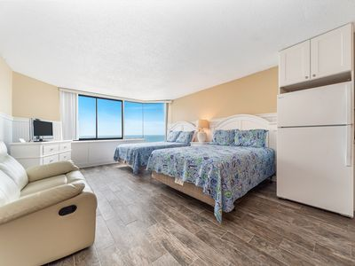 Photo for New Listing! Beautiful studio right on the beach! Pool, private beach access!