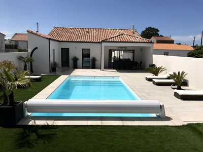 Photo for Villa with heated pool, terrace, garden, town center 300m, beach 600m