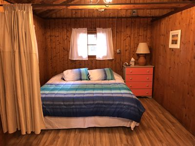 """Photo for Cozy """"Beach"""" Cabin in the woods with Pentwater Lake frontage and access"""