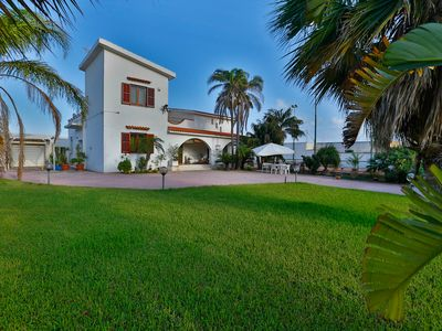 Photo for Large villa at the sea surrounded by greenery with tennis court