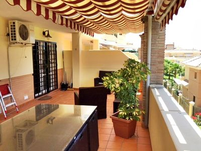 Photo for Beautiful apartment located near golf and beach, large terrace, A / C and wifi.