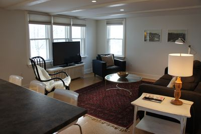 Bright, comfortable livingroom to relax in with large flatscreen TV