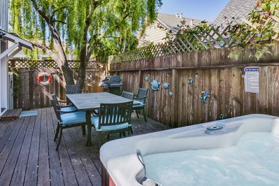 New deck with new hot tub and outdoor dining area!