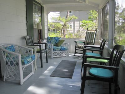 the screened porch at the front of the house with ocean views.