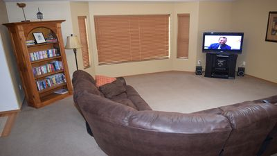 View #2 of family room. flat screen tv with blue ray player, and satellite tv.