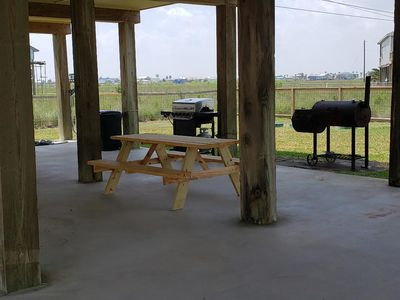 Under the house there is a gas and charcoal grill with picnic table .  Enjoy!
