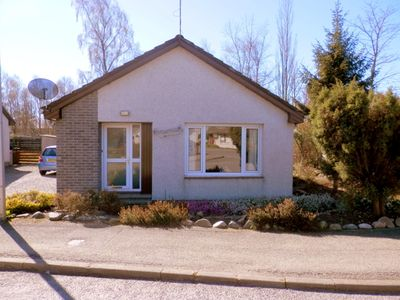 Photo for 3 bedroom bungalow overlooking the woods and Cairngorm Mountains.