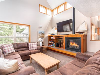 Photo for Cozy beach house with hot tub, new floors and furniture!