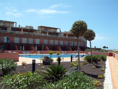 Photo for Marfolin 1 El Cotillo. Beachfront apartment with direct access to pool & beach