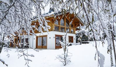 Photo for Spacious chalet for 10/12 with hot tub. Ideal for families, skiing, biking, golf