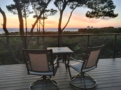 2 person table with sunset and ocean views. from the deck.