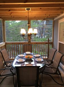 Screened porch with Table for Six and porch swing.