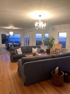 Living room and dining room with expansive views of the beach