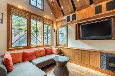 Open and bright living area with HDTV and gas fireplace