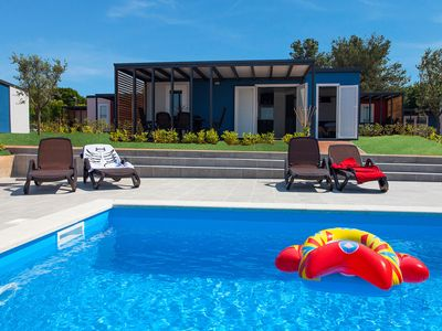 Photo for Beautiful chalet, sharing a swimming pool with a few other chalets, in a park near the sea