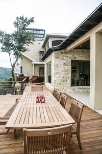 outdoor dining area with outdoor grill on the side