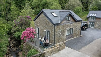 Photo for Modern Contemporary Cottage with Riverside Terrace and free WiFi