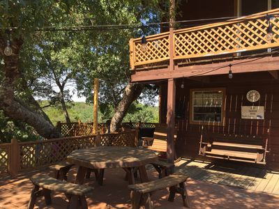 two decks with plenty of outdoor seating.